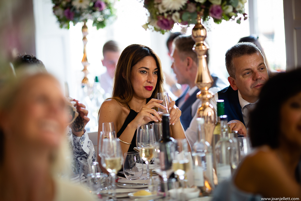 pretty lady listening to the speeches holding a glass