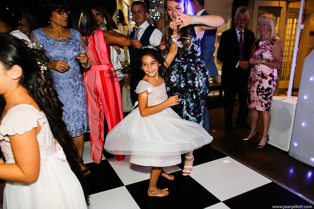 little girl sibling on the dance floor