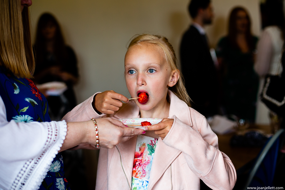 little guest eating a strawberry