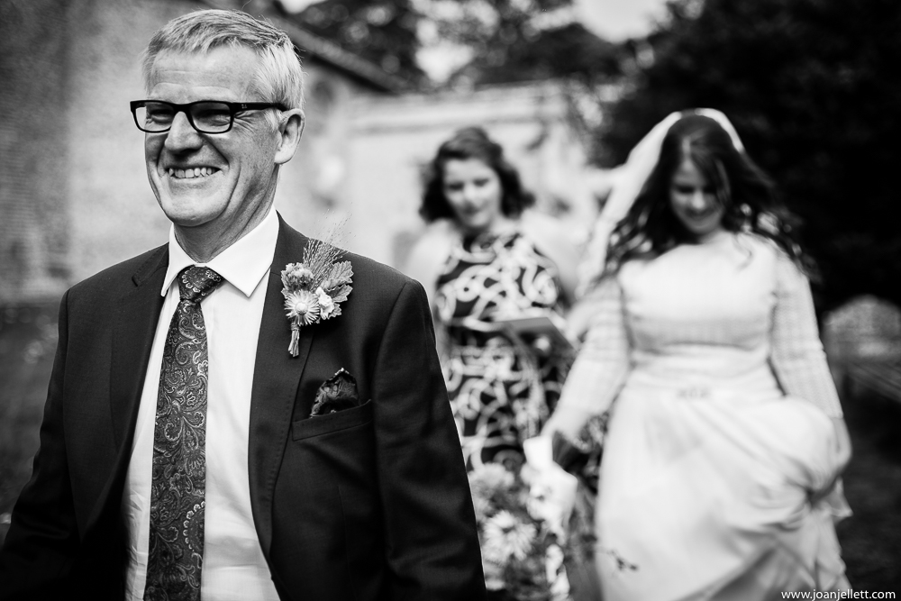 father of the bride happy his daughter next to him