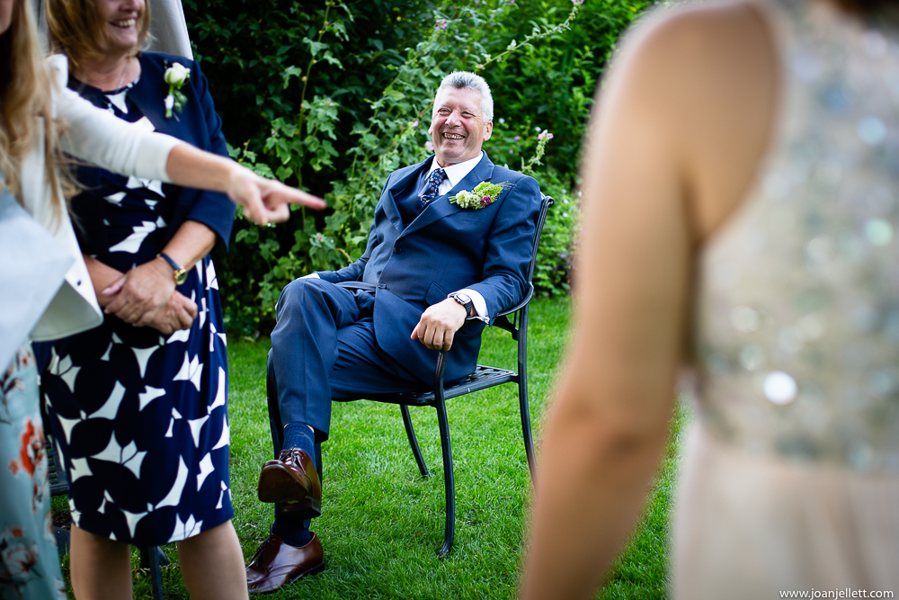 father of the groom sitting down