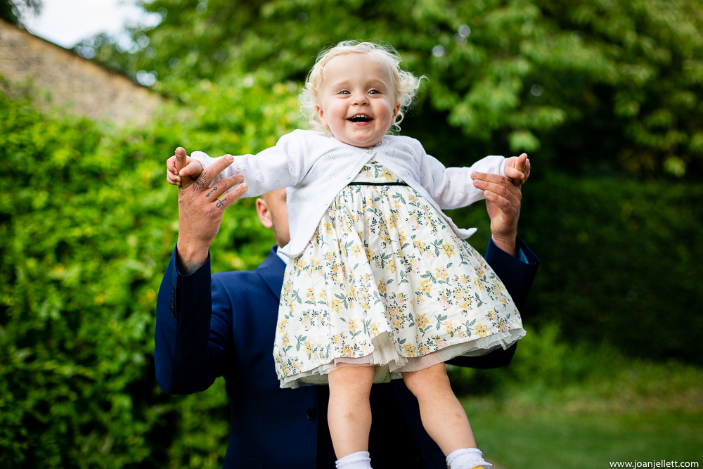 little girl in the air with daddy