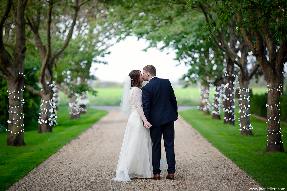 bride and groom kissing at south farm