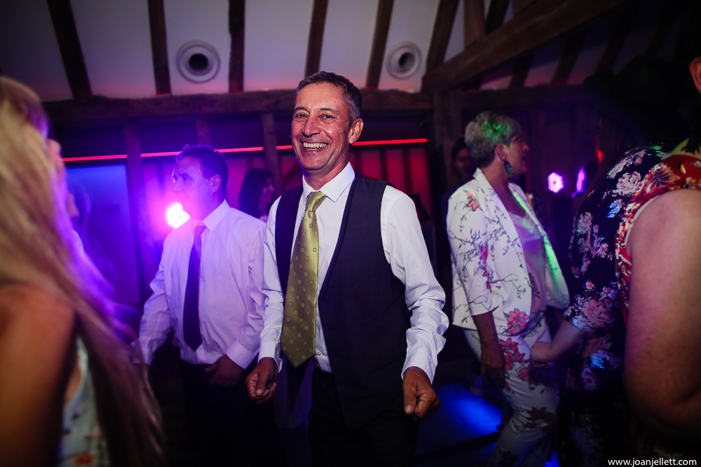 father of the bride smiling and dancing