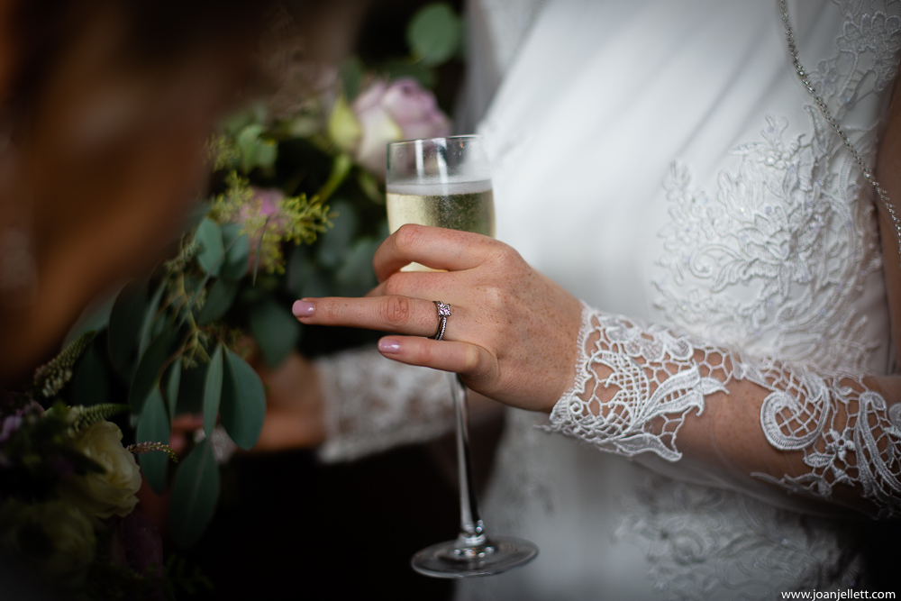 bride showing her wedding ring off