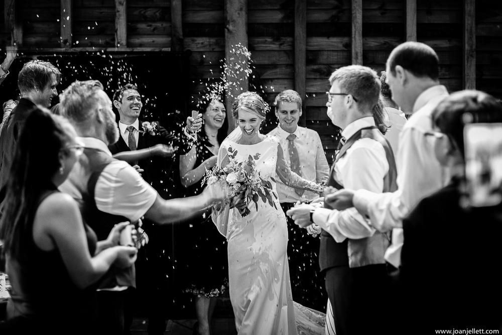 bride walking down the aisle confetti everywhere