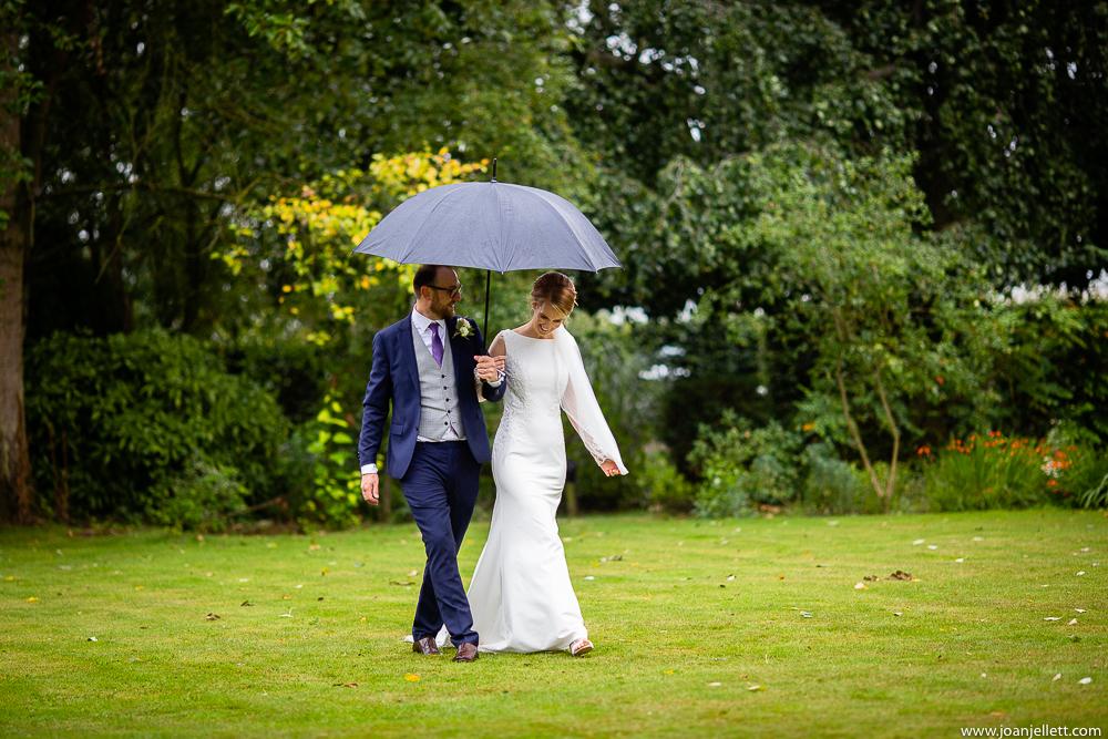 bride and groom walking in redcoats