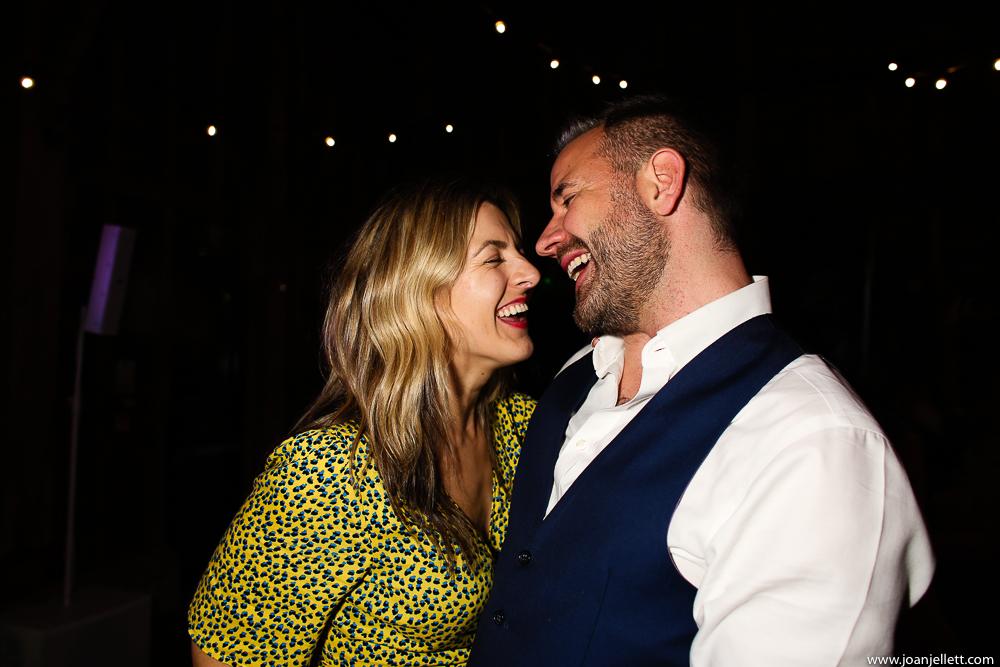 couple laughing on the dancefloor