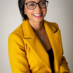 CEO of Bournemouth headshot session wearing a yellow suit jacket