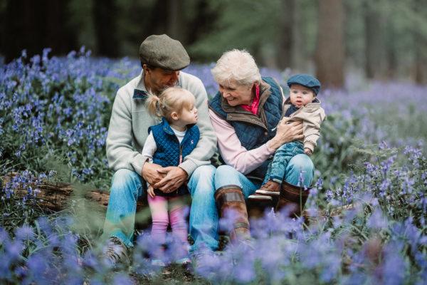 family in the bluebells in Dorset