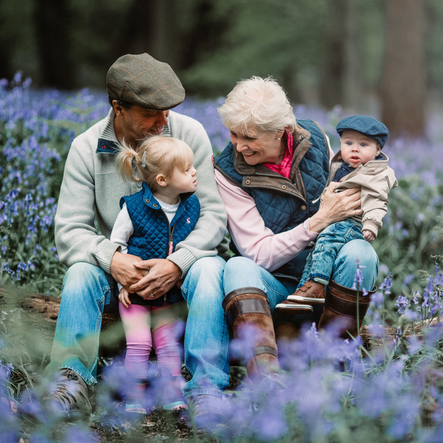 family in the bluebells in Dorset