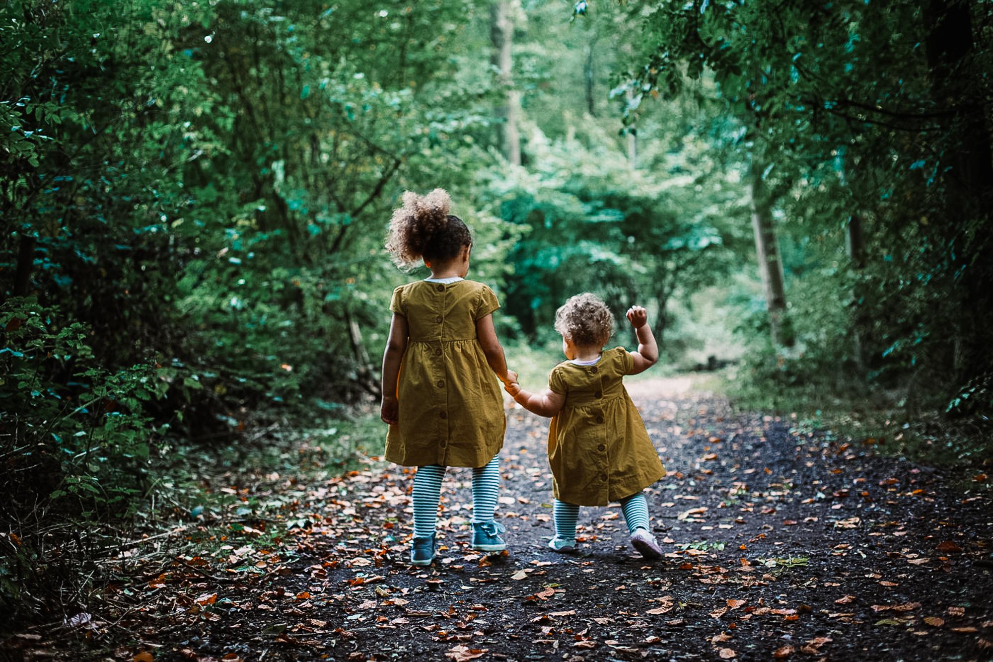 sisters walking hand in hand