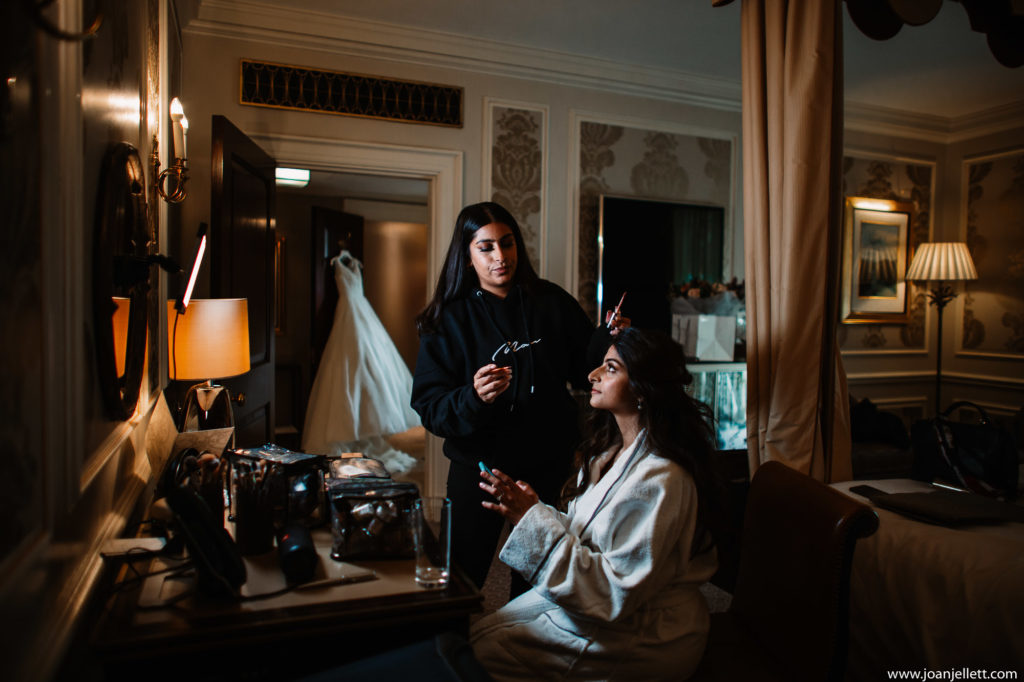 Bride having her makeup done at the dorchester hotel